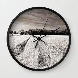 Tracks in the field Wall Clock