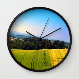 Tipping the scenery Wall Clock