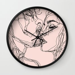 kiss more often Wall Clock