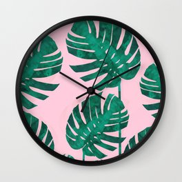 Tropical leaves on pink background Wall Clock