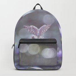 Sun rays and bokeh effect over the butterfly Backpack
