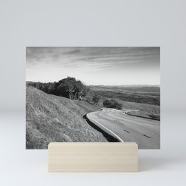 Winding road along the rolling hills near San Simeon, CA Mini Art Print