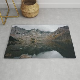 Mountains In The Clouds In Front Of A Lake Rug