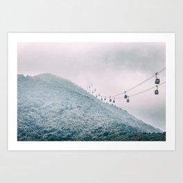 Cable car on a misty mountain high up Art Print