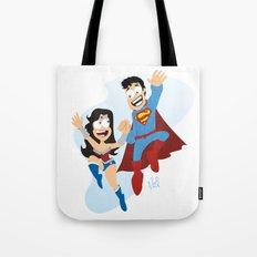 couple dressed as heroes. Tote Bag
