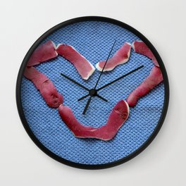 St Valentine design with potato peel on blue background Wall Clock