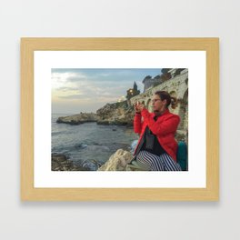 Woman taking a picture in a beach in the Rovinj city center Framed Art Print