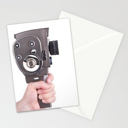 Retro mechanical hobbies movie camera in hand Stationery Cards