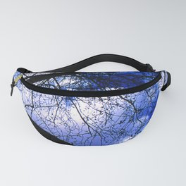 Urban maple tree in a winter evening with a city building and a cloudy sky Fanny Pack