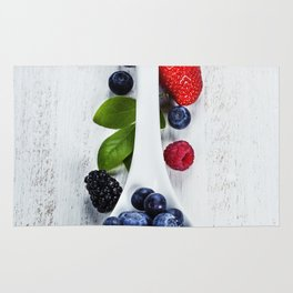 Berries with spoon Rug