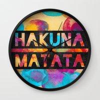 hakuna Wall Clocks featuring Hakuna matata by Elisabeth Fredriksson