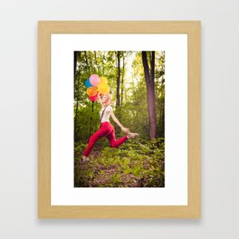 Beautiful blonde girl with colourful baloons in nature  Framed Art Print