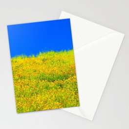 yellow poppy flower field with green leaf and clear blue sky Stationery Cards