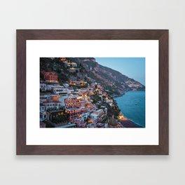 Positano sparkling at dusk Framed Art Print