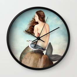 the soul is full of longing Wall Clock