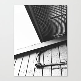 wood building in the city in black and white Canvas Print