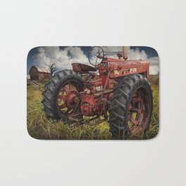 Abandoned Old Farmall Tractor in a Grassy Field on a Farm Bath Mat