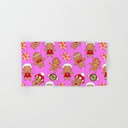 Cute decorative hygge seamless pink pattern. Happy gingerbread men and sweet xmas caramel chocolate Hand & Bath Towel