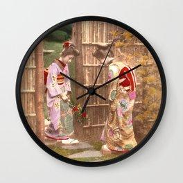Japanese women walking on stepping stones Wall Clock