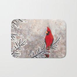 The Red Cardinal in winter Bath Mat