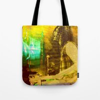 drums Tote Bags featuring playing opium drums by ARTito