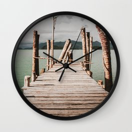Jetty by the sea, moody view Wall Clock