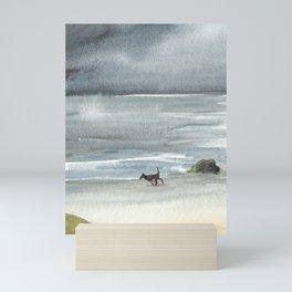 Black Dog on a Stormy Beach Mini Art Print