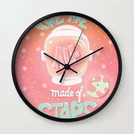 We are all made of stars, typography modern poster design with astronaut helmet and night sky, pink Wall Clock