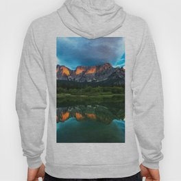 Burning sunset over the mountains at lake Fusine, Italy Hoody