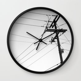 Wires and pole in front or sky Wall Clock