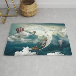 The boy and moon Rug