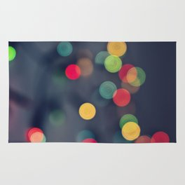 Blurred background with multicolored lights of garland Rug