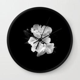 geranium in bw Wall Clock