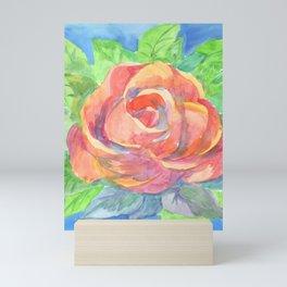 Red rose, green leaves and blue sky Mini Art Print
