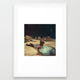 Something in the water Framed Art Print