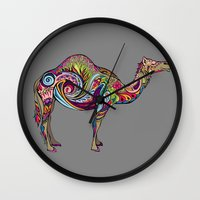 camel Wall Clocks featuring Camel by Green Girl Canvas