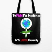 feminism Tote Bags featuring Global feminism by MoonAries