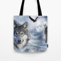 wolves Tote Bags featuring Wolves by Julie Hoddinott