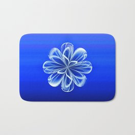 White Bloom on Blue Bath Mat