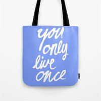yolo Tote Bags featuring YOLO by Pink Berry Patterns