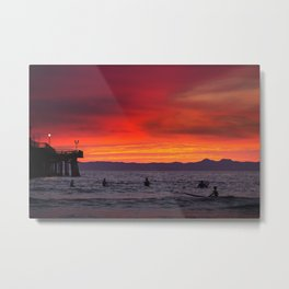 Surfers watching Sunset Metal Print