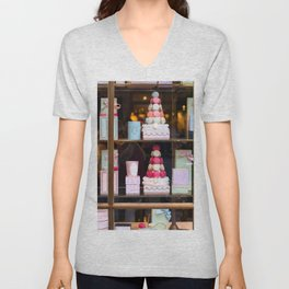 Beautiful colorful tasty macaroons cakes sweets and presents in the boxes display in window at the  Unisex V-Neck
