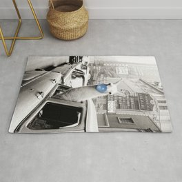 Yummy Blue Bubble Gum Llama taking a New York Taxi black and white photography Rug