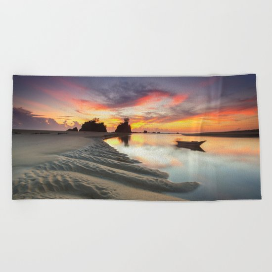Canoe on the Water at Sunset  Beach Towel