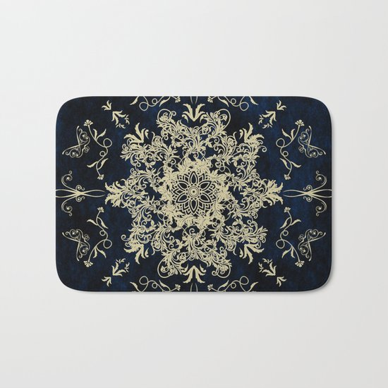 Pale Gold Floral Design On A Blue Textured Background Bath Mat
