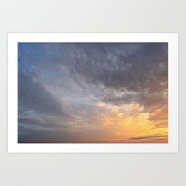 Glowing sky clouds at sunset Art Print