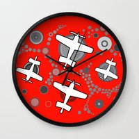 airplanes Wall Clocks featuring airplanes in red by Isabella Asratyan