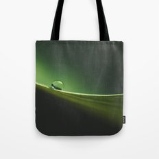 a drop on the edge Tote Bag
