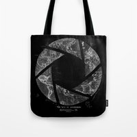 aperture Tote Bags featuring Traveling Lens by Tobe Fonseca