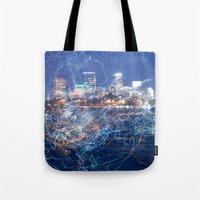 minneapolis Tote Bags featuring Minneapolis Neon by Andrew C. Kurcan